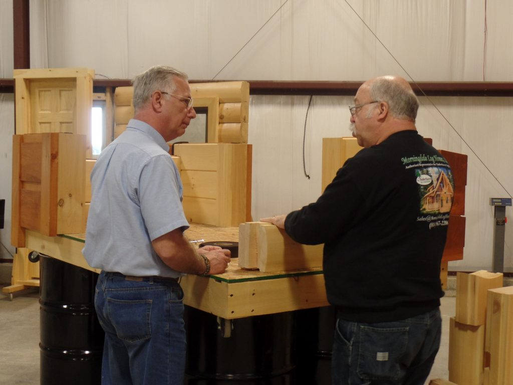 Art Hoffman of Morningdale Log Homes explaining log home corner joinery to a Client
