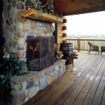 Morningdale Log Homes, log home exteriors, outdoor fireplace on deck