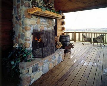 Morningdale Log Homes, log home exteriors, outdoor fireplace on deck