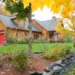 Morningdale Log Homes, log home exteriors, red garage doors