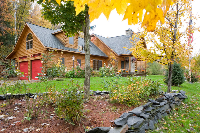 Morningdale Log Homes, log home exteriors, red garage doors